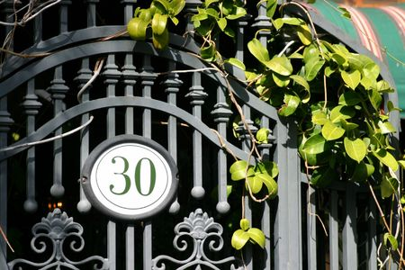 blacksmith shop: Iron door with the number 30 and some green