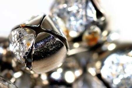 Silver shiny bells close up on white background Stock Photo