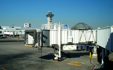 Jetway at an airport with control tower in the background. Stock Photo - 4023890