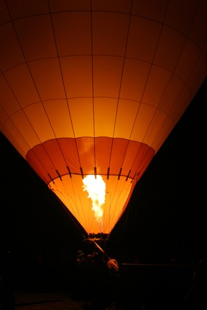 inflating: Hot air baloon with flame from burner. Stock Photo