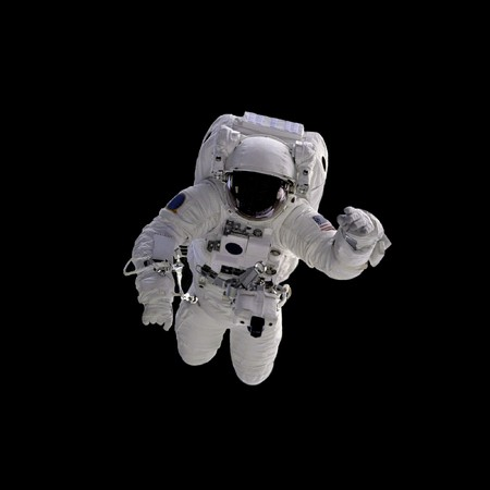 a courtesy: Flying astronaut on a black background.  Some components of this image are provided courtesy of NASA, and have been found at nasaimages.org Stock Photo