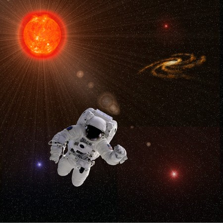 Flying astronaut on a background with Sun Stars  Some components of this image are provided courtesy of NASA, and have been found at nasaimages.org Stock Photo