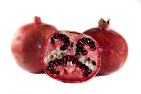 Red yummy juicy pomegranate on white background. photo