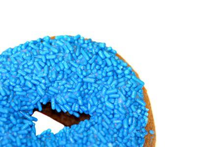 Blue doughnut in bottom left corner on white background Stock Photo - 4889081