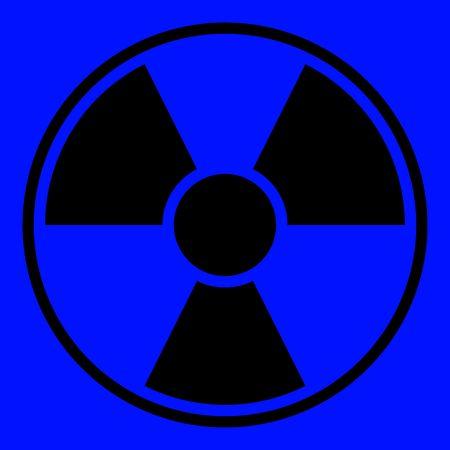 Round radiation warning sign on blue background Stock Photo - 5277372