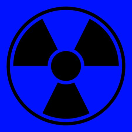 uranium: Round radiation warning sign on blue background