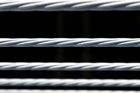 Metal fence wire on a black background photo