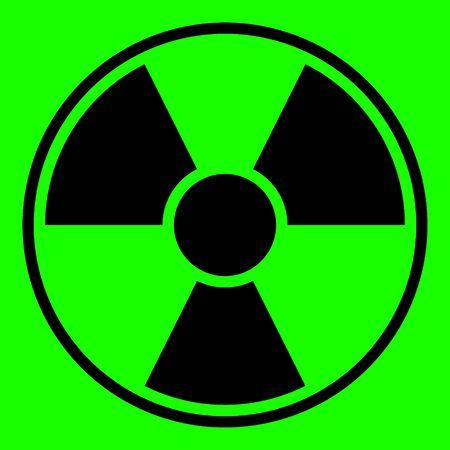 Round radiation warning sign on green background