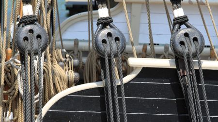 close up of block and rigging on a sail boat