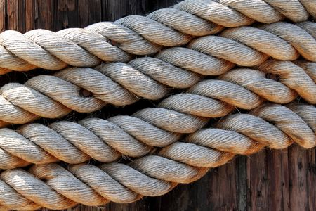 old rope to tied a sail boat to the pier photo