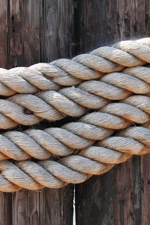 old rope to tied a sail boat to the pier Stock Photo