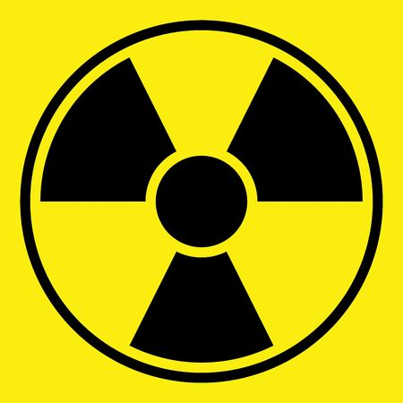 Round radiation warning sign on yellow background Stock Photo - 5996270