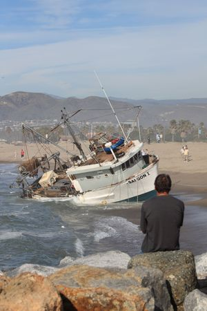 VENTURA, CA, USA - January 8, 2010 - The fishing boat SAI GON I ran aground after 4 people were rescued early morning. The rescue team tried to free the boat throughout the day January 8, 2010 in Ventura, CA