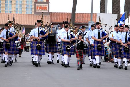 march band: EDITORIAL ONLY  VENTURA, CA, USA - October 11, 2009 - Bagpipe bands participating in a parade at the Ventura Seaside Highland Games October 11, 2009 in Ventura, CA