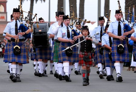 marching: EDITORIAL ONLY  VENTURA, CA, USA - October 11, 2009 - Bagpipe bands participating in a parade at the Ventura Seaside Highland Games October 11, 2009 in Ventura, CA
