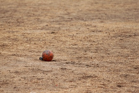 Metal ball been thrown in a competition photo