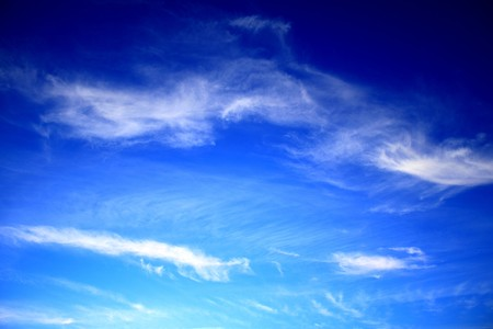 Blue sky with white clouds on a sunny day.