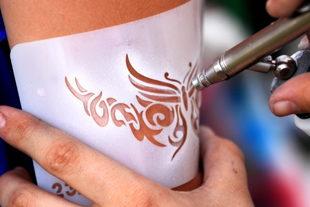 arm: creating an air brush tatoo on a youn gilrs arm