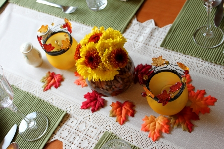 A orange yellow autumn centerpiece for Thanksgiving Stock Photo