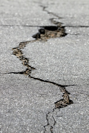 earthquake crack: close up of a crack in the street