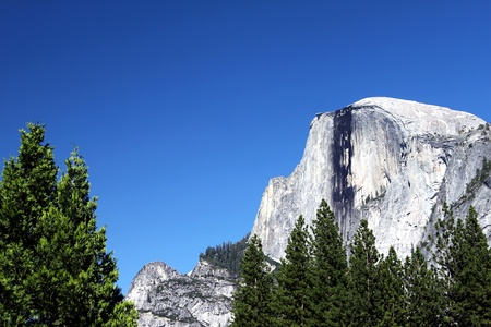 Yosemite Half Dome with a beautiful blue sky.
