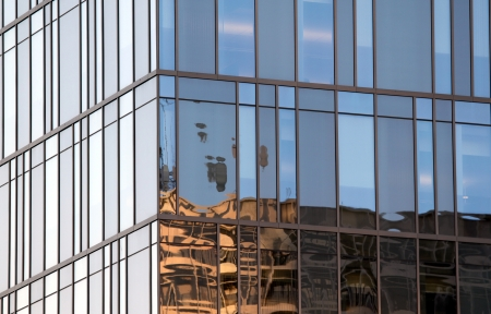 Large wall of glass windows at a tall building  photo