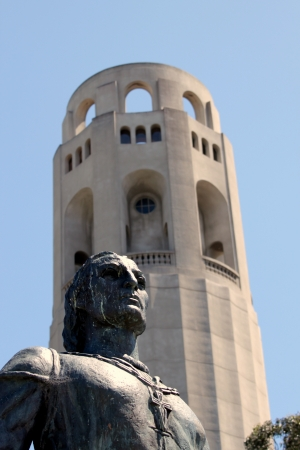 Coit Tower in San Francisco with the statue of Columbus in the front  photo