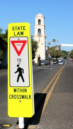 Neon yellow crosswalk sign in down town Ojai
