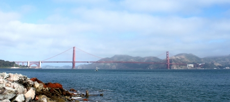 Golden Gate bridge in San Francisco with water in the front  photo