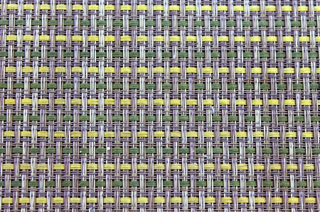 Placemat with yellow and green woven parts  photo