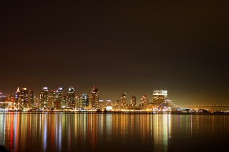 san diego: The skyline of San Diego at night with reflection in the water