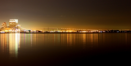 The skyline of San Diego at night with reflection in the water  photo