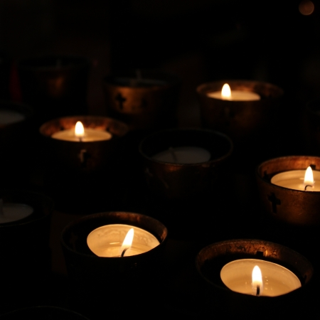 Candles in a church on black background Stock Photo - 17631419
