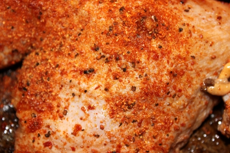 Closeup of chicken spiced with pepper and paprika