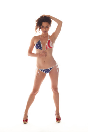 Woman with a USA bikini on white background. photo