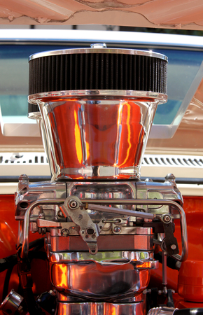Close up of a chrome engine with reflection. photo
