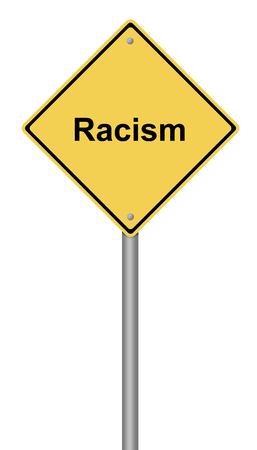 Yellow warning sign with the text Racism. Stock Photo