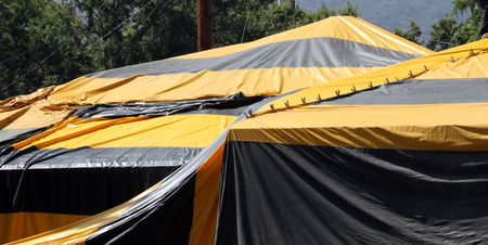eradication: Black and yellow termite fumigation tent over an house. Stock Photo