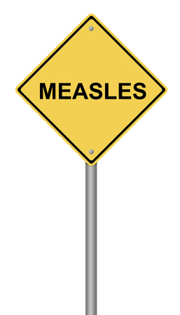 measles: Yellow warning sign with the text Measles. Stock Photo