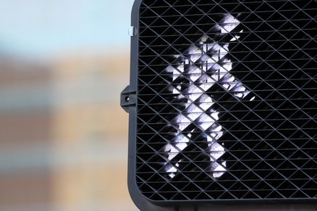 proceed: Pedestrian signal that shows you can walk. Stock Photo