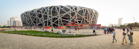 olympic stadium: BEIJING, CHINA - SEPTEMBER 21, 2015: Tourists walking around the Bird Nets - China Natinal Olympic Stadium in Beijing, China, September 21, 2015