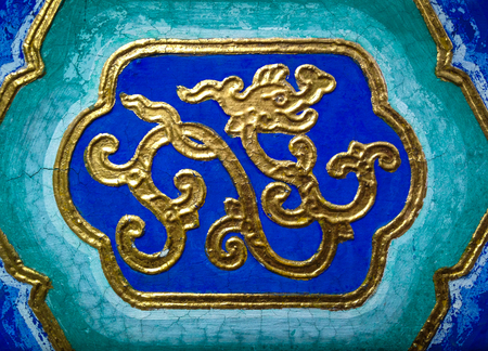 Abstract golden dragon on a ceiling in a temple. Stock Photo