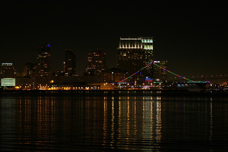 The skyline of San Diego at night with reflection in the water. Stock Photo