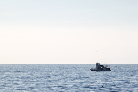 Small fishing out on the Pacific ocean water. Stock Photo