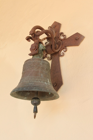 An old bell at the wall of a church. Stock Photo