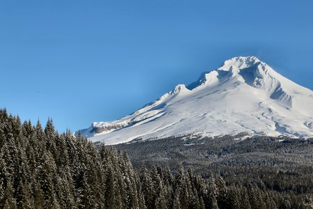 mount hood: Mount Hood in Winter, showing the south side with the Timberline ski area and Silcox Hut barely visible near the center.