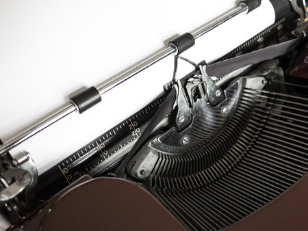 Old Burgundy Red Typewriter with White Blank Page