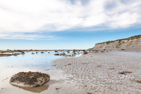 low angles: Eroded Cliffs and Sandy Beach at Low Tide
