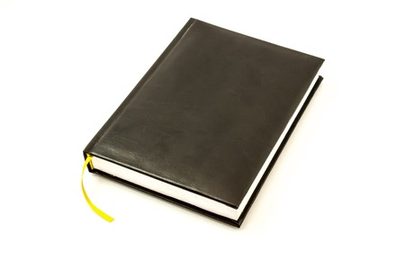 memo pad: Simple black leather memo pad for note with yellow bookmark lies on a white background