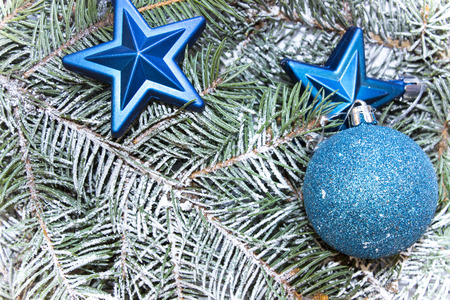 top of the year: Various decorations for the Christmas and New Year, shiny toys,  stars lie on fir branches. top view